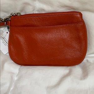 NWT Classy COACH Orange Leather Wristlet